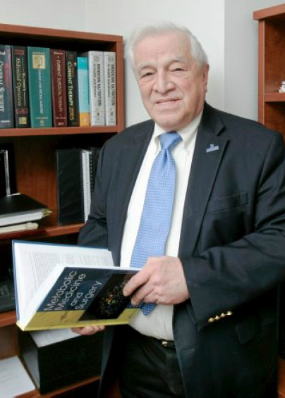 Dr. Dudrick with a book
